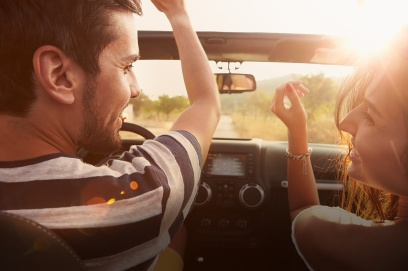 stock-photo-61343436-young-couple-driving-along-country-road-in-open-top-car_final