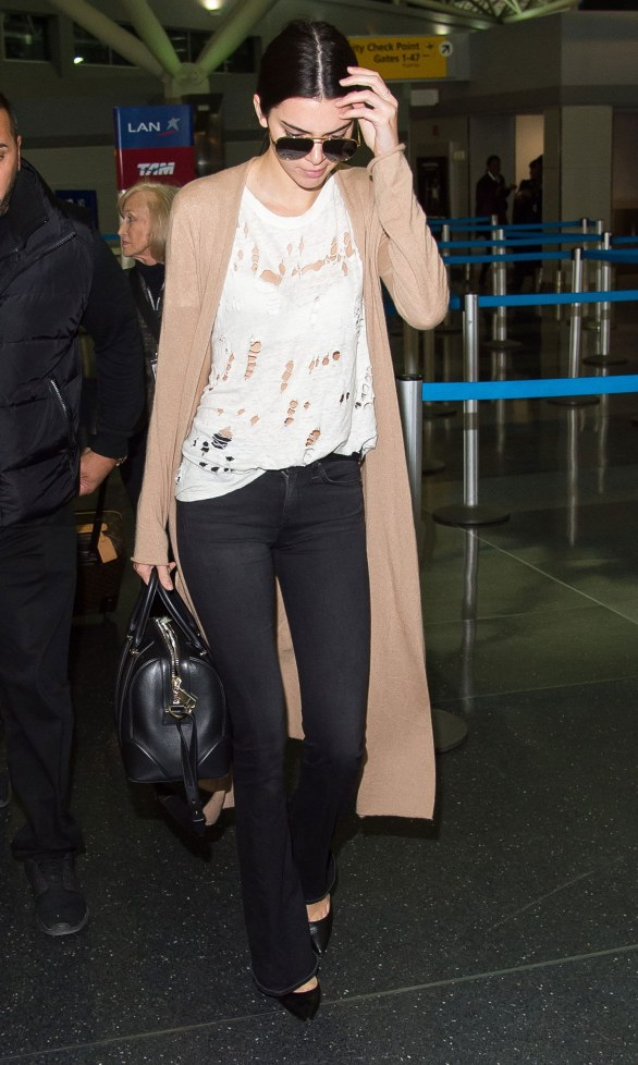 fashion-2016-03-kendall-jenner-ripped-white-t-shirt-with-holes-main