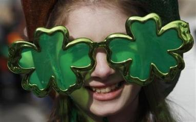 A reveller wears shamrock-shaped sunglasses during a St Patrick's Day parade near Trafalgar Square in central London