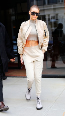 Gigi Hadid bears her toned midriff when walking out of her apartment in New York