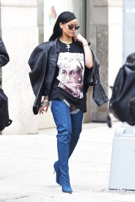 Rihanna wears her limited edition Manolo Blahnik belted boots and Princess Diana t-shirt as she heads to her concert in Newark, NJ