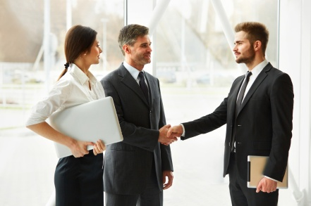 Business People. Successful Business Partner Shaking Hands in the office. Business Team