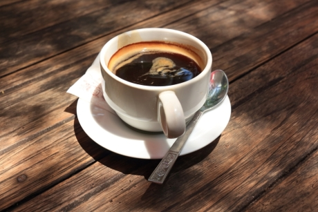 to-coffe-or-not-to-coffee-is-that-even-a-question-coffee-cup-hot-americano-coffee-on-a-table-s-940x626